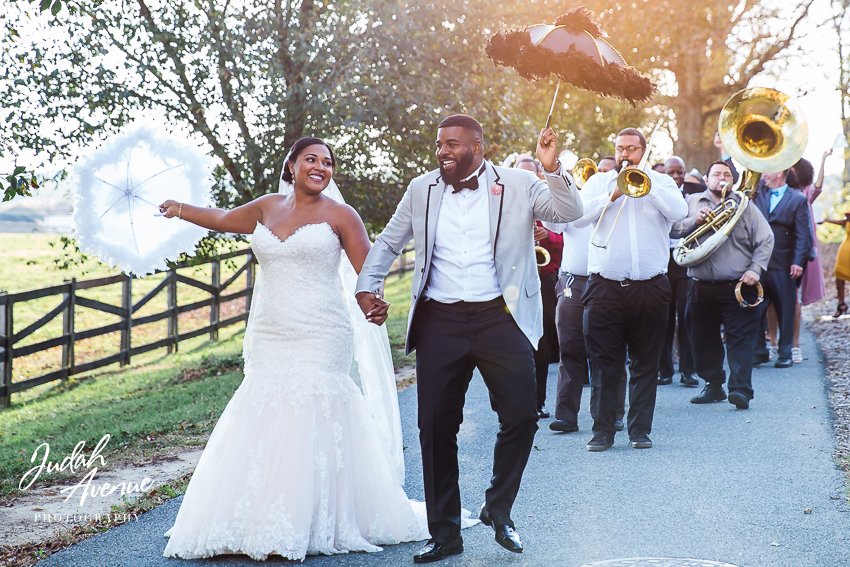 wedding photographer woodlawn manor photo of a wedding with brass band and second line